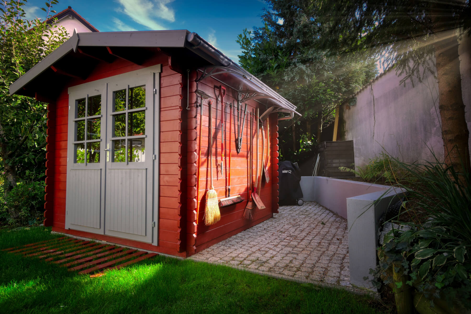 Garden shed placed on cobbles